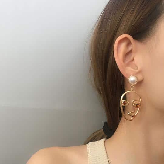 Pearl Face Hollow Earrings $7.00