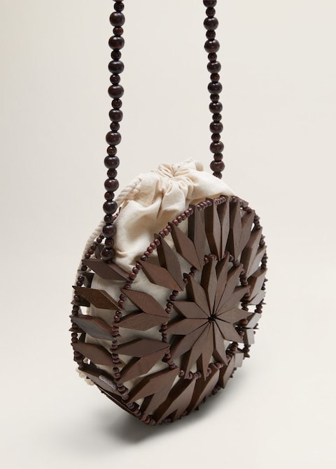 Beaded wood bag $49.99