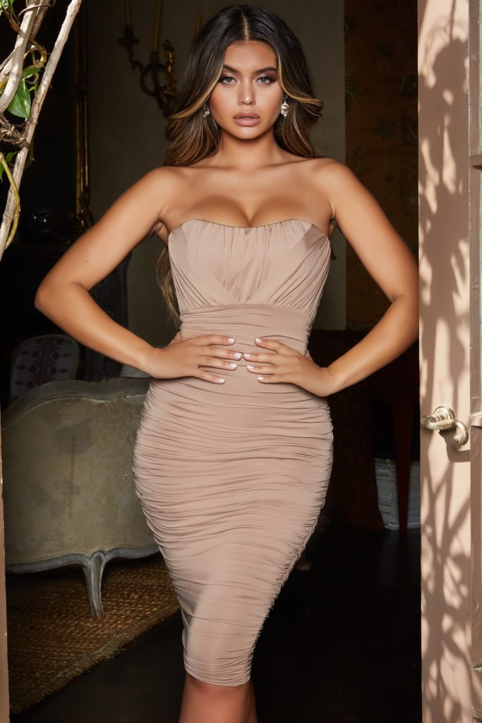 BUSTIER RUCHED DRESS IN PEACH $54.59