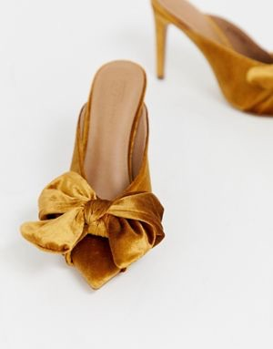 pointed high heel mules with bow $56.00