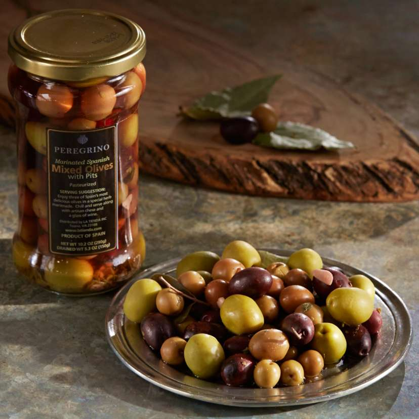 Spanish Mixed Olives by Peregrino Marinated in Herbs and Garlic $6.95