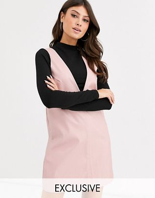 sleeveless shift dress in faux leather$60.00
