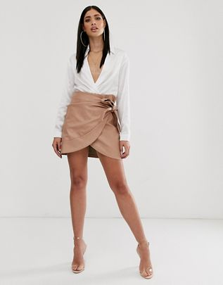 Parallel Lines leather look wrap front mini skirt with bow detail in tan $45.00