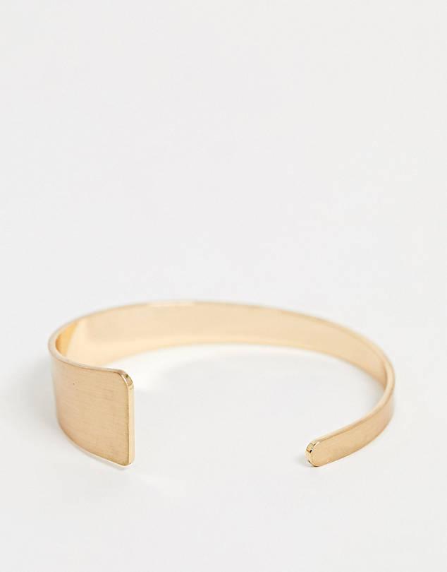 cuff bracelet in graduating design in gold tone $9.50
