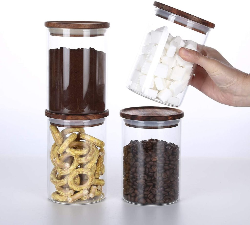 2 Glass Jars Wooden Lids $38.00