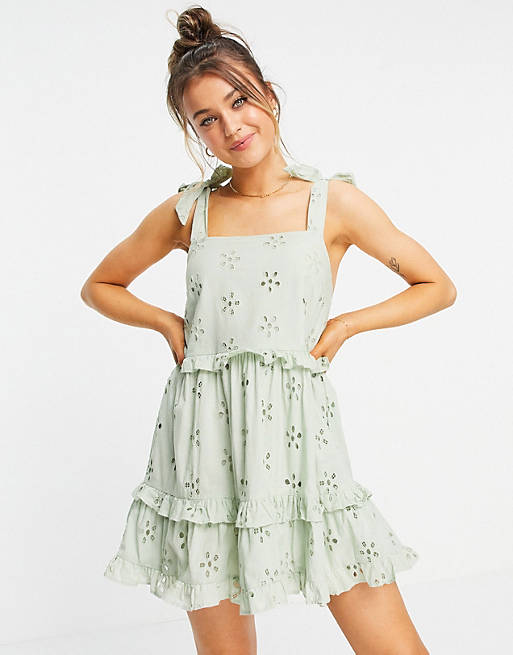 Broderie ruffle swing mini sundress with tie straps in sage green $36.00