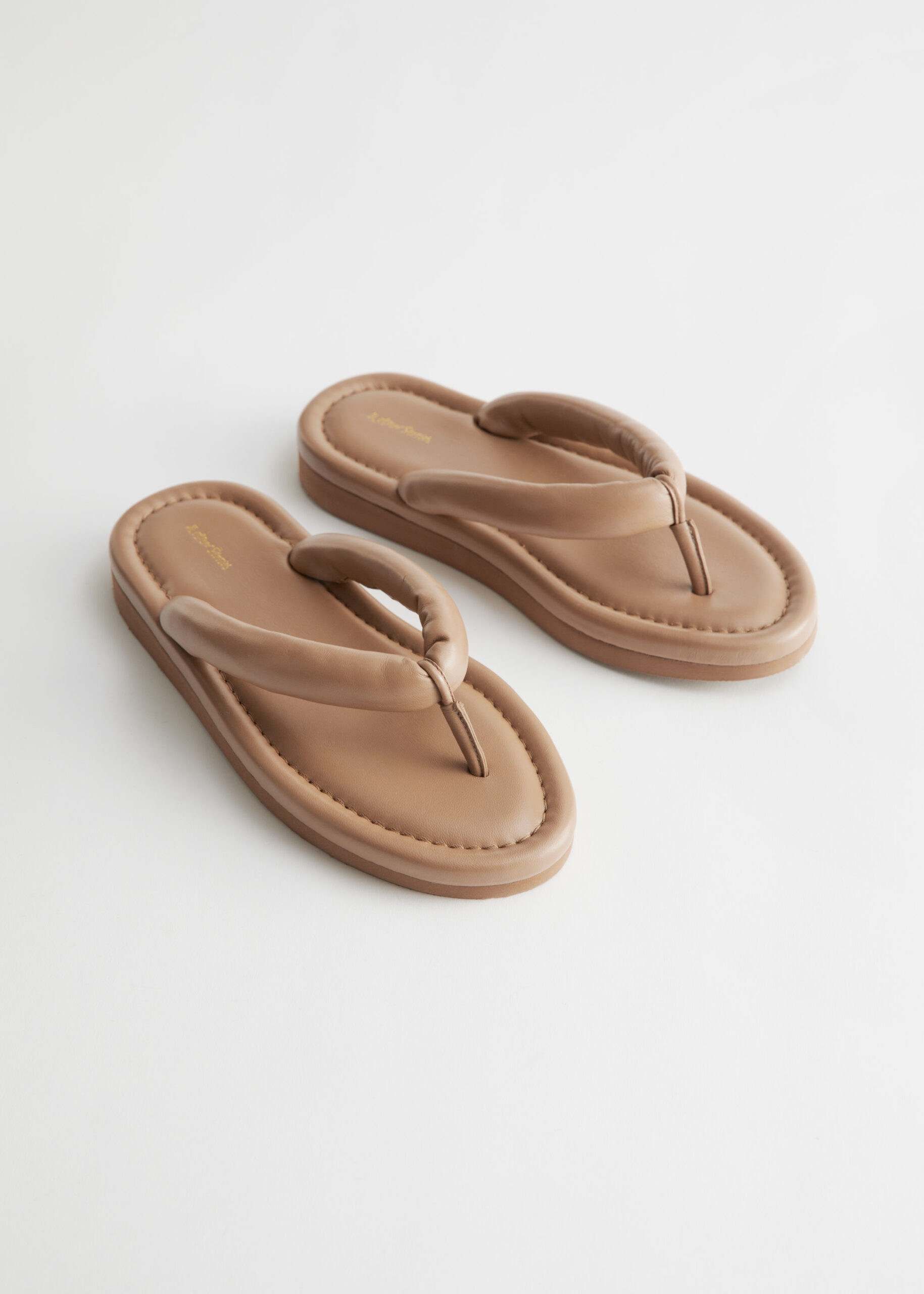 Padded Strap Leather Flip Flops $129