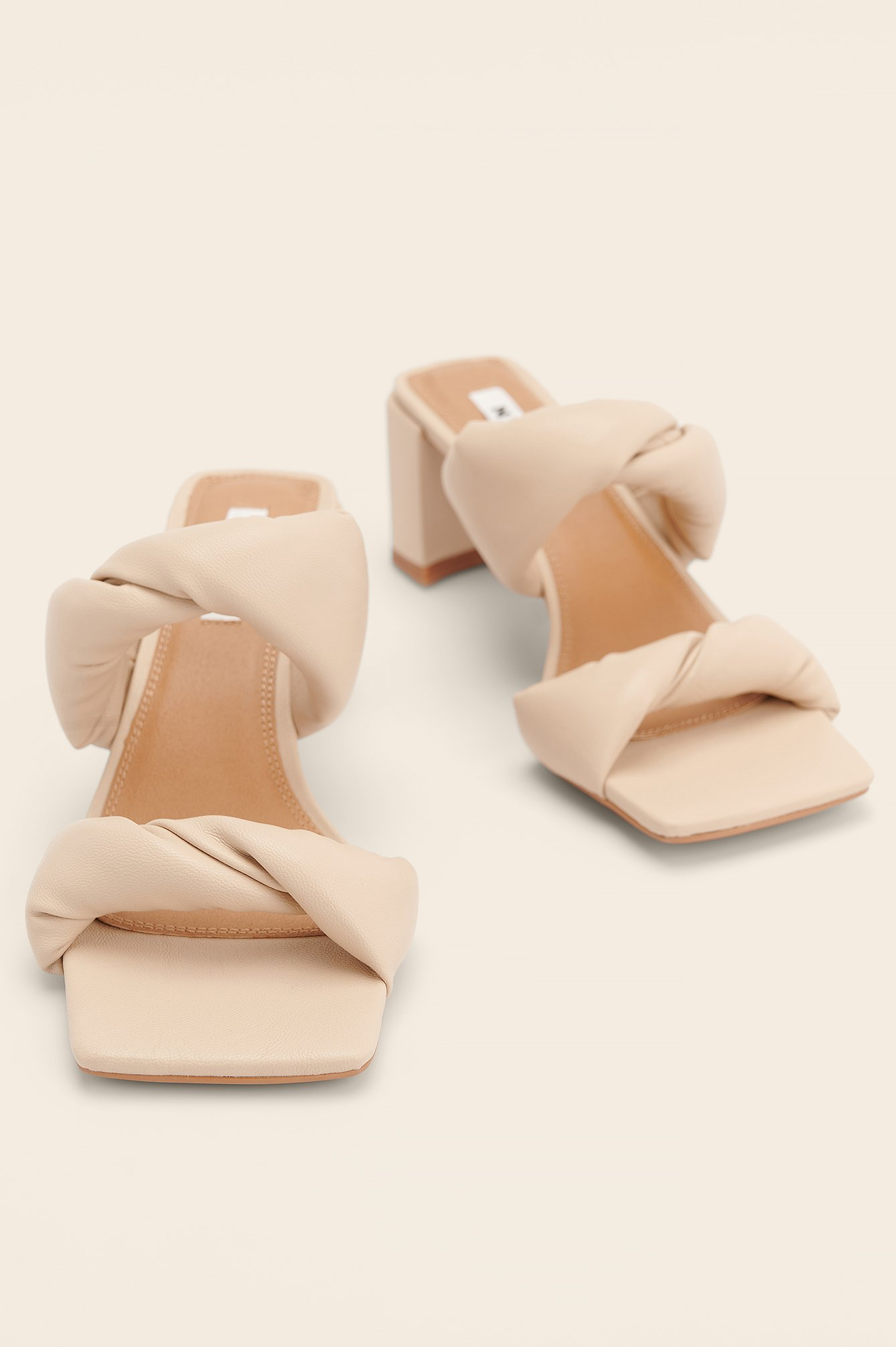 Twisted Squared Toe Mules  $47.95